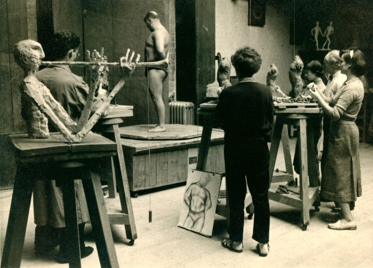 Sculpture life room c. 1955, right to left- Reid Moffat,  sculpture of trumpet player by Alan Fletcher  - Sheila McLaughlin back to us, Eleanor Christie (furthest away), Benno Schotz and Janie Alston. Big Jimmy, the model.